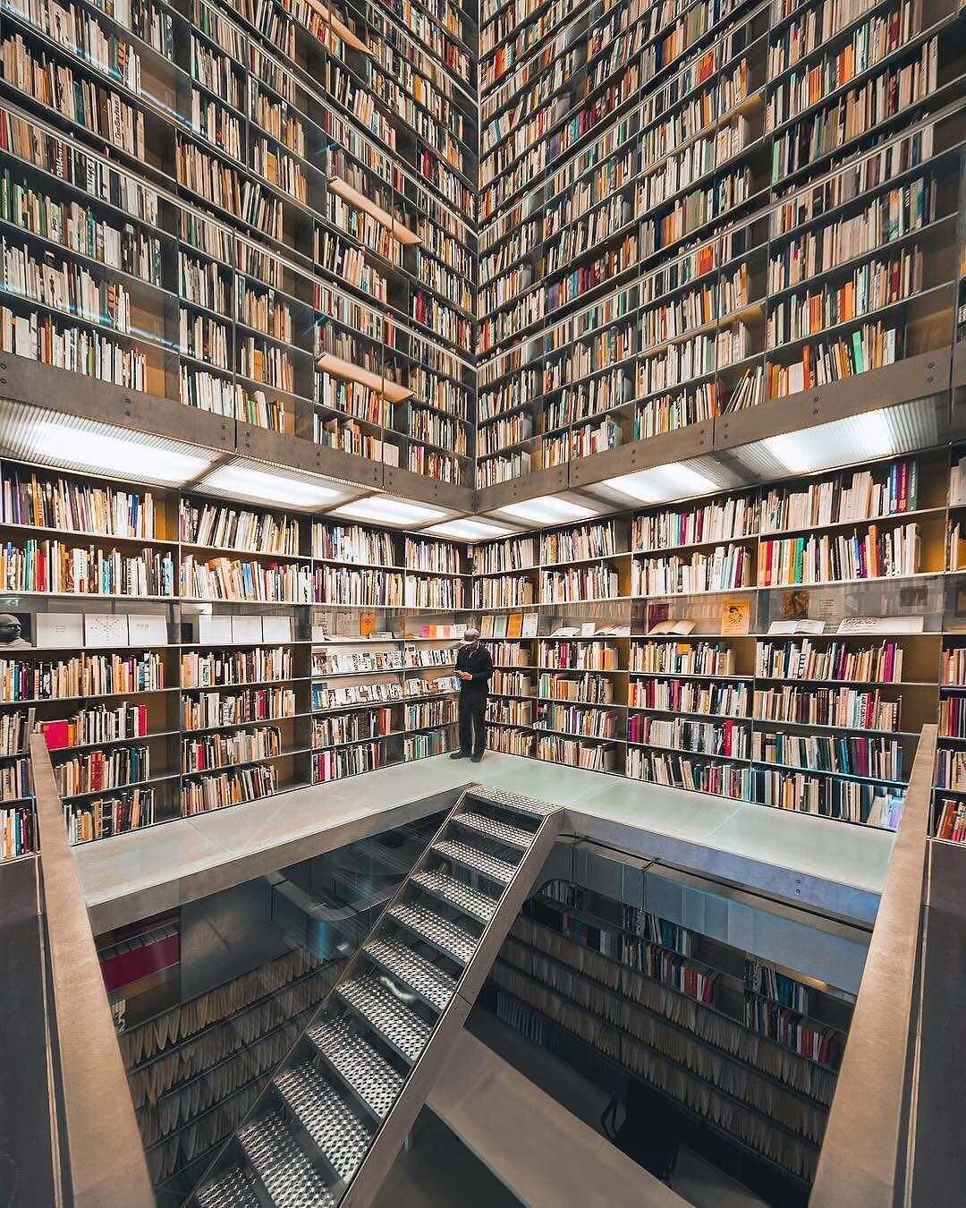 For Bibliophiles Bookshops And Libraries Can Transport People To Another Place Where You Re By Yourself But You Are Never Eindhoven Bookshop Modern Library