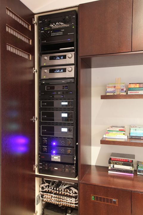equipment rack neatly conceals home automation system electronics