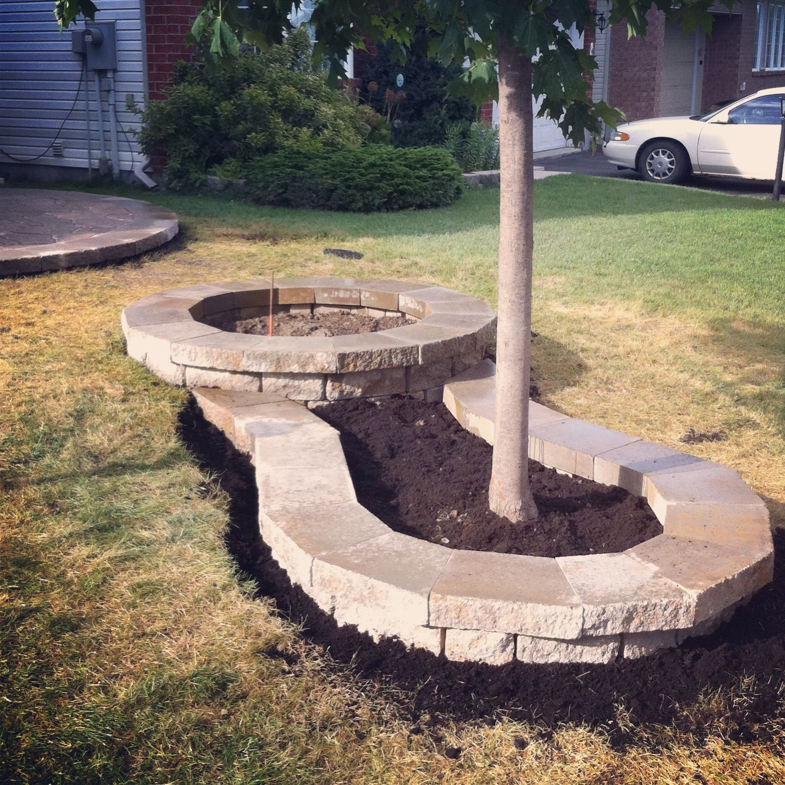 small kidney shaped flower bed we used celtic block natural stone