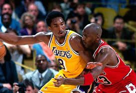 Kobe Bryant posting up Michael Jordan in a matchup between two of the better teams in the NBA, The Los Angles Lakers and The Chicago Bulls. As well two of best basketball players to ever play.