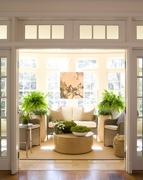 Crisp Sunroom With Transom Windows Light Colored Wicker White And Beige Cushions Green Ferns And Plants Spa Sunroom Designs Sunroom Decorating Garden Room