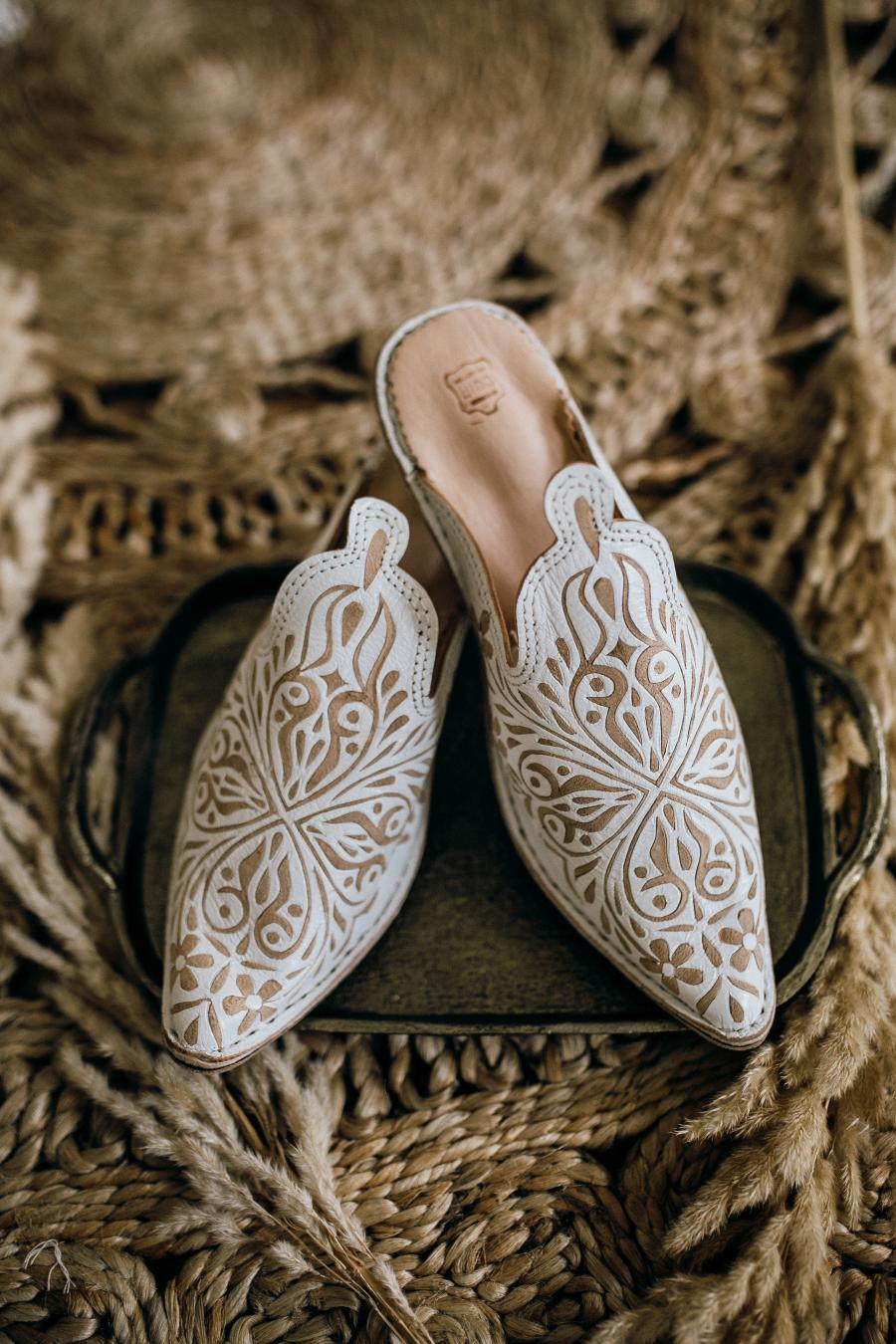 Moroccan Wedding Shoes is part of Boho wedding shoes, Boho wedding accessories, Boho wedding gifts, Wedding dress shoes, Wedding accessories, Boho wedding - EMBROIDERED WHITE LEATHER MOROCCAN WEDDING BOOTS  SOURCED DURING A MAGICAL AND EYE OPENING BACKPACKING TRIP THROUGH MOROCCO LAST SPRING  BEAUTIFUL SCALLOP EDGES AND TAN DETAILING HIGHLIGHTS THE BEAUTY OF THE HAND EMBROIDERED SHOES