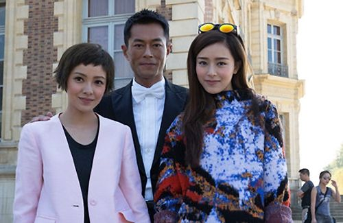 """Louis Koo, Amber Kuo, and Janice Man arrive in Paris to film new romantic comedy, """"Holiday in Paris""""."""