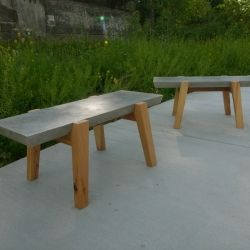 Lincoln Supply Benches By John Truex Have Cast Concrete Tops With Bases Made From Reclaimed Old Growth Pine Salvage Furniture Design Concrete Design Furniture