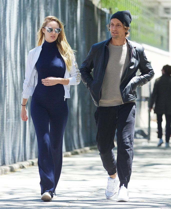 e1ecf0f6fde3 Candice Swanepoel showed off her baby bump in a skin-tight navy blue  jumpsuit.
