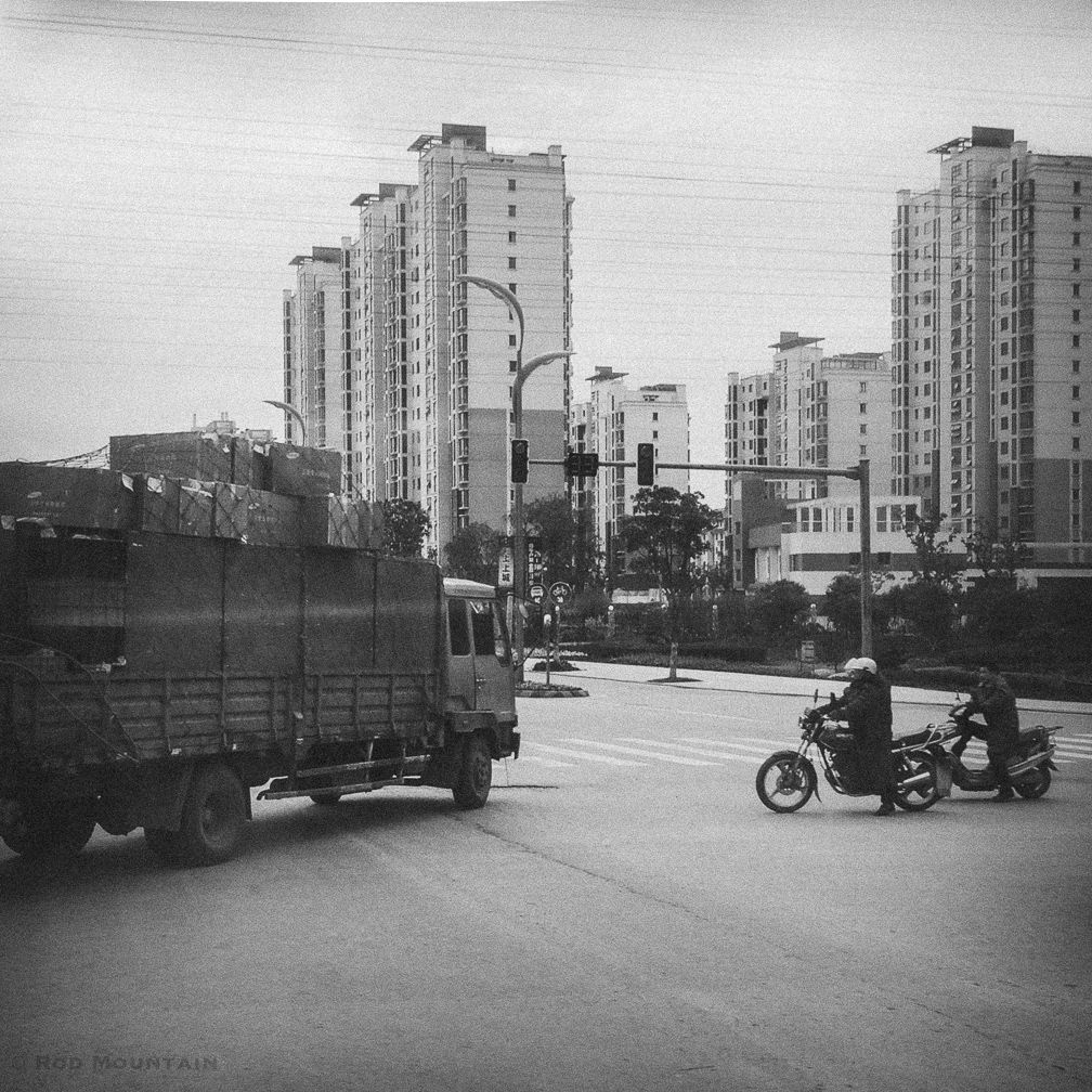 SuZhou, Shanghai, China - Motorcyclists yield to traffic turning left at an intersection in China.  Image: © Rod Mountain  #latergram #visitchina #chinaculture #China #Traffic #SuZhou #Shanghai #photostory #createexplore #bnw_of_our_world #top_bnw #love_bnw #worldlust #ourplanetdaily #earthofficial #ig_great_pics #shotwithlove #worldbestgram #bnwmood #bnw_planet #foto_bw #mono #best_bnw_archive #mono #blancinegre #bw