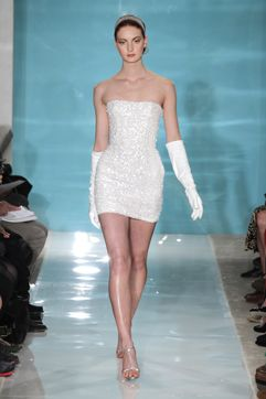 Reem Acra's sexy little number, featuring all-over sequin appliques, is toned down with glamorous white opera gloves.