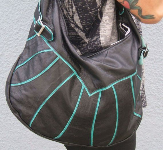 Medium-Large size hobo-style bag with adjustable buckle strap. Lined with black and white striped cotton