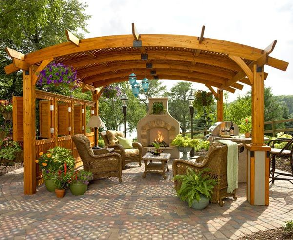outdoor living space ideas - An arched pergola offers a unique