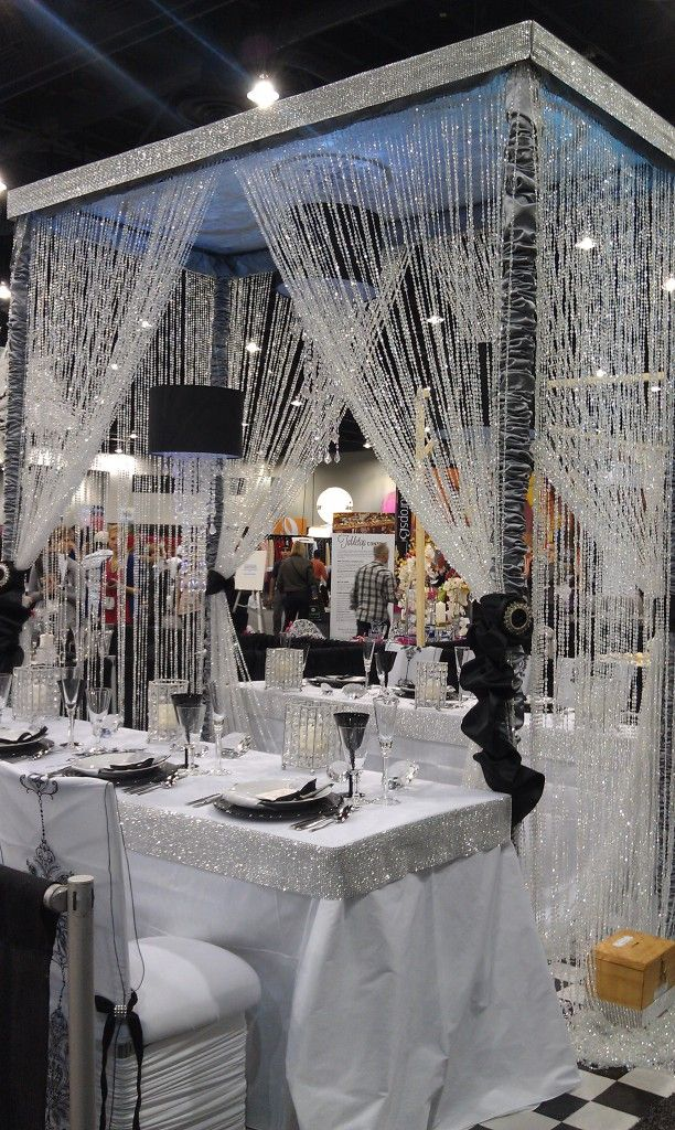 crystal strands over black and white themed table