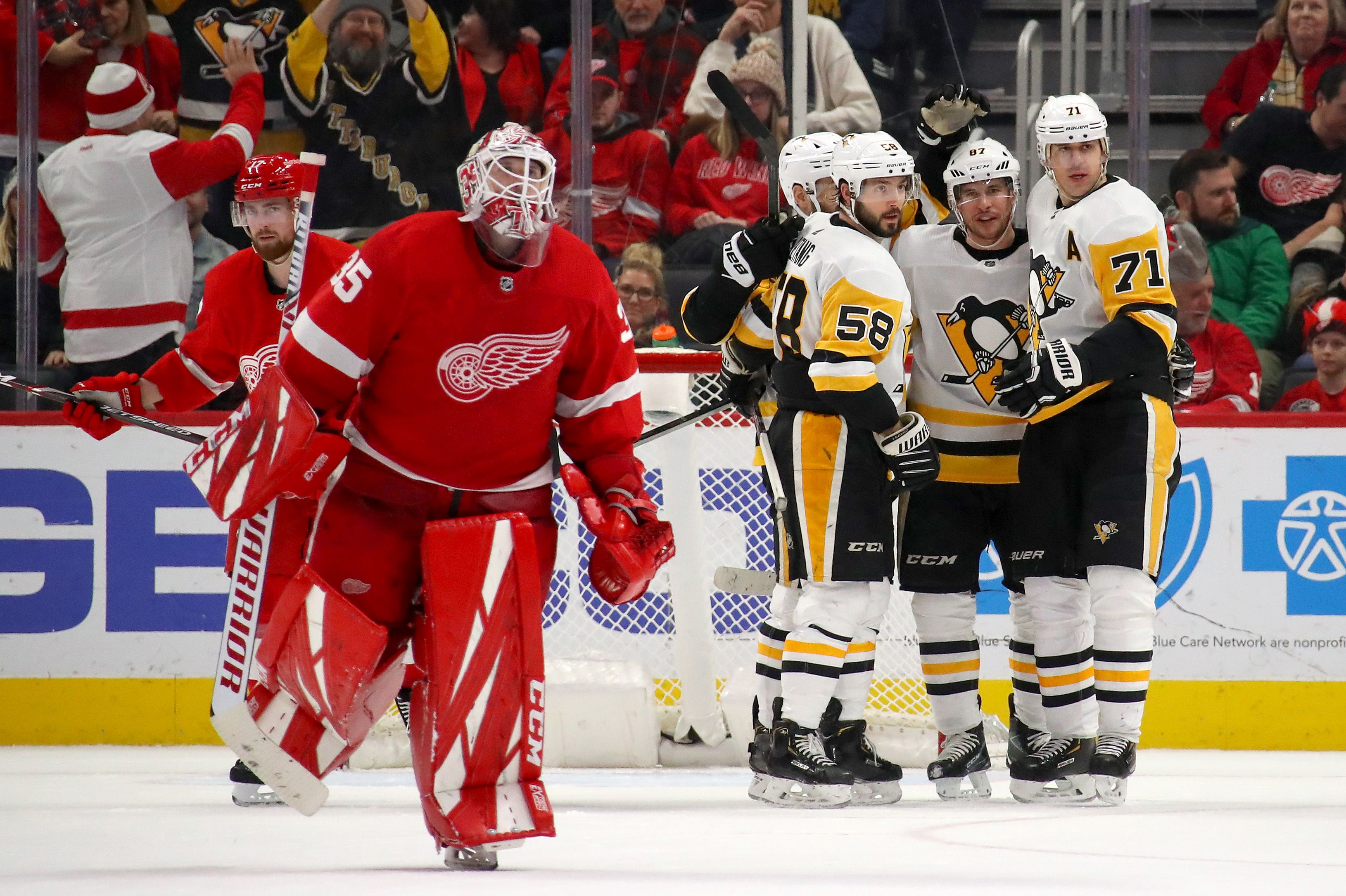 The Pittsburgh Penguins Celebrate Sidney Crosby S Overtime Goal In The Penguins 2 1 Victo In 2020 Detroit Red Wings Clothing Detroit Red Wings Detroit Red Wings Funny