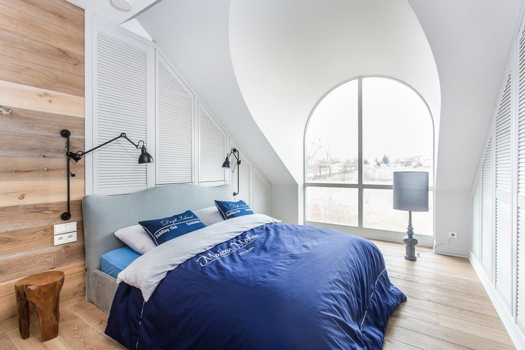 This Modern Attic Bedroom Is Decorated In Natural Wood And White
