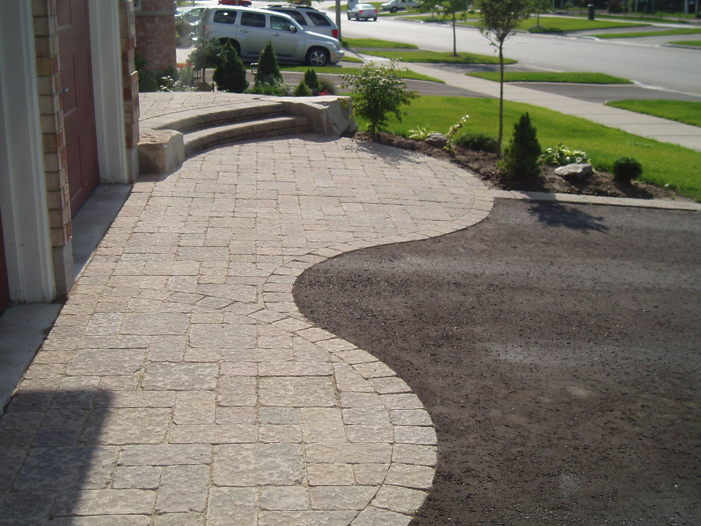 Driveway design houses curb appeal by installing a curved driveway design houses curb appeal by installing a curved interlock stone design solutioingenieria Gallery