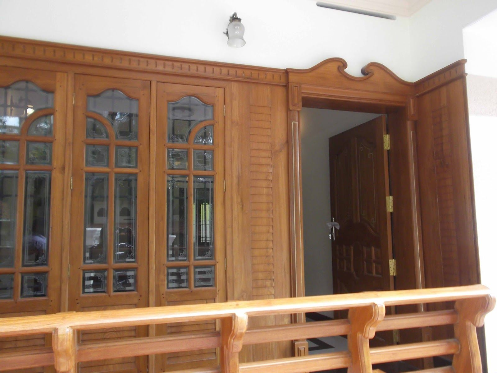 House windows frame design - Kerala House Front Door Designs Models