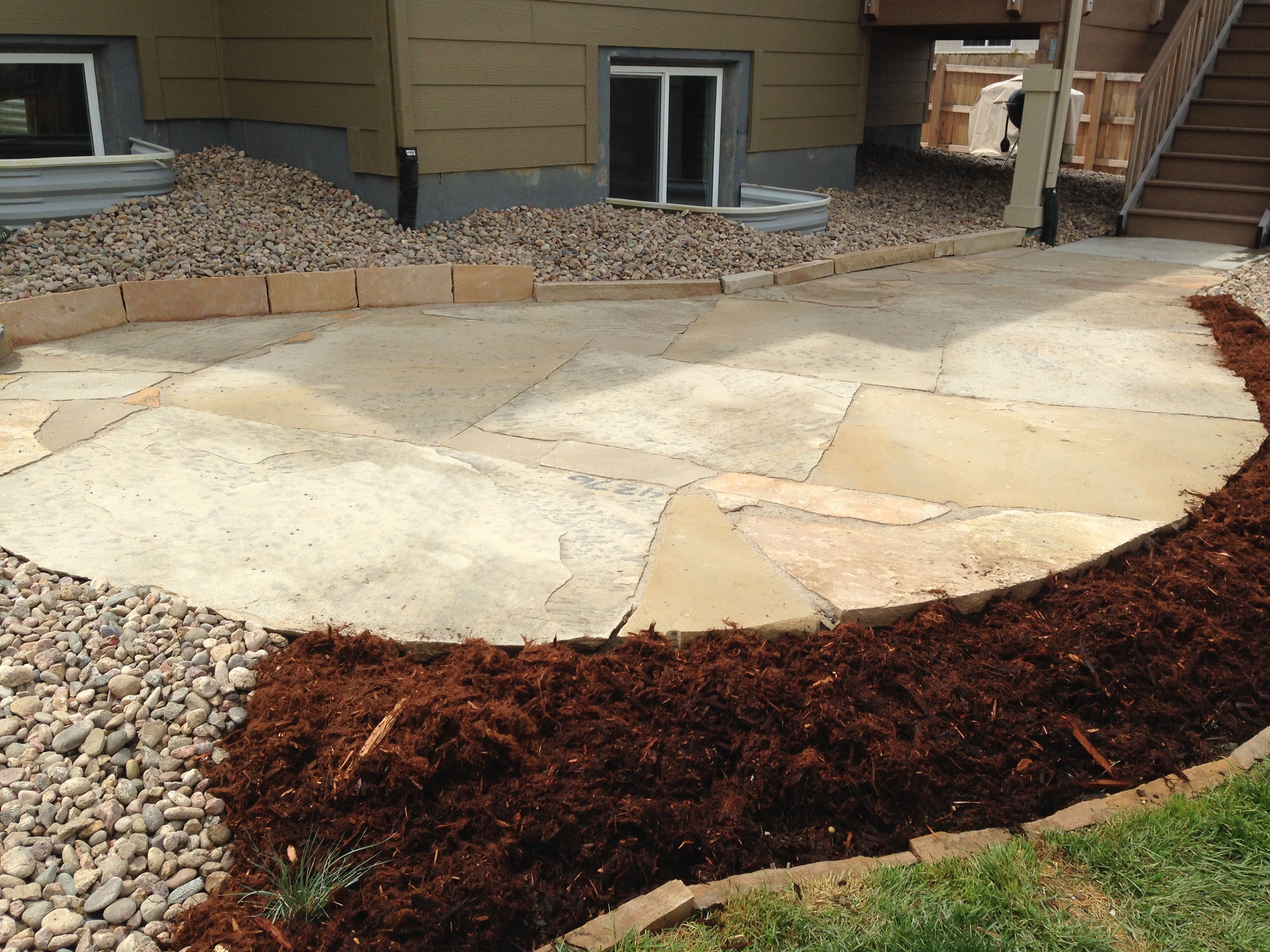 Colorado buff flagstone patio with really large pieces for Flagstone patio designs