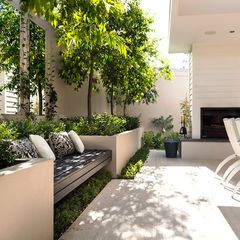 The bench and concrete plant boxes.  -modern patio by Swell Homes