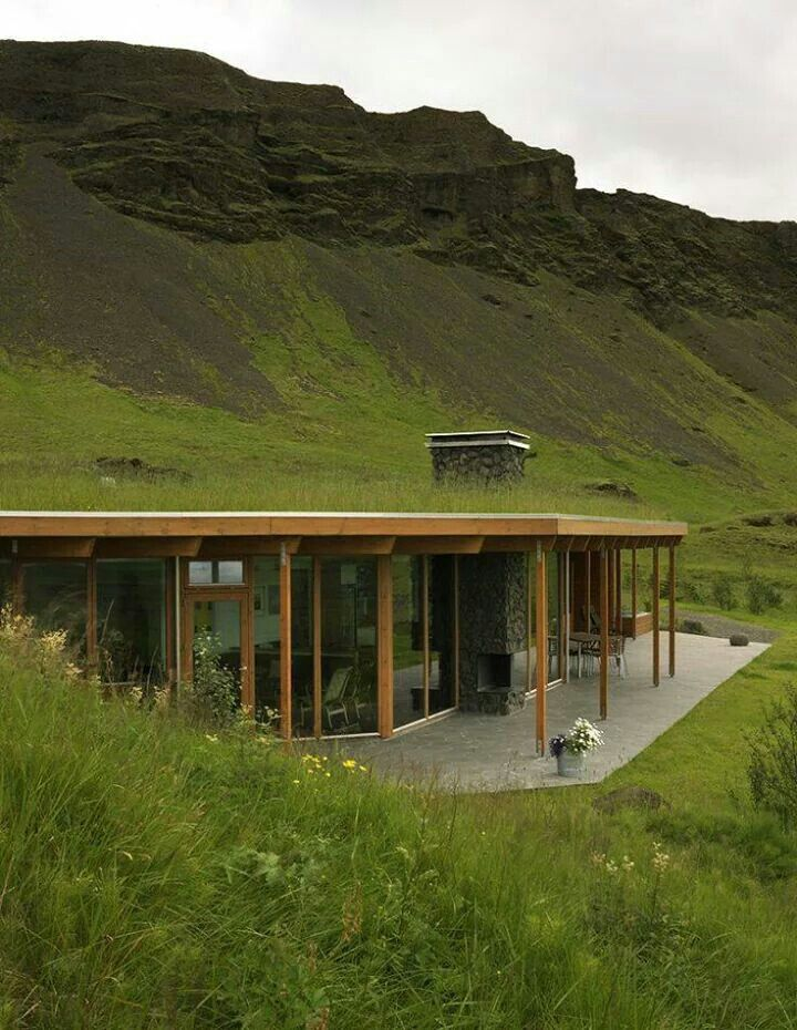 Half burried underground house with green grass roof and for Malator underground eco house