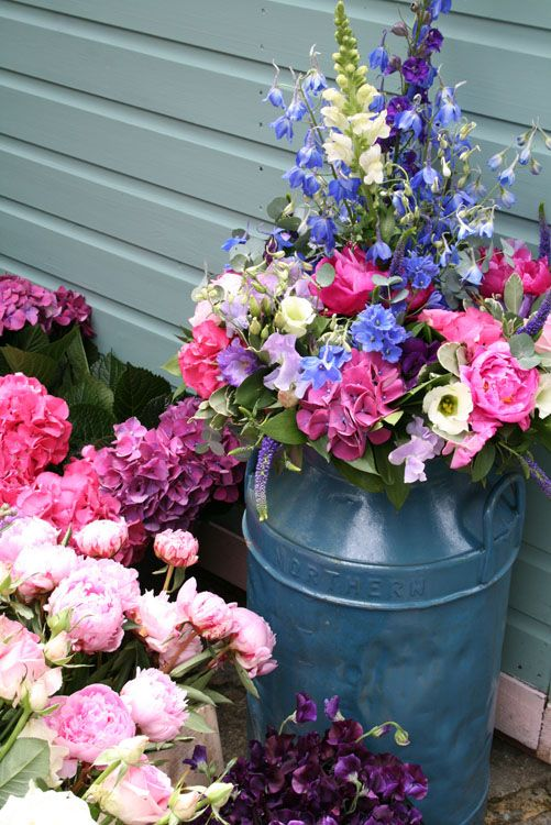 Pink and blue wedding flowers, milk churn display