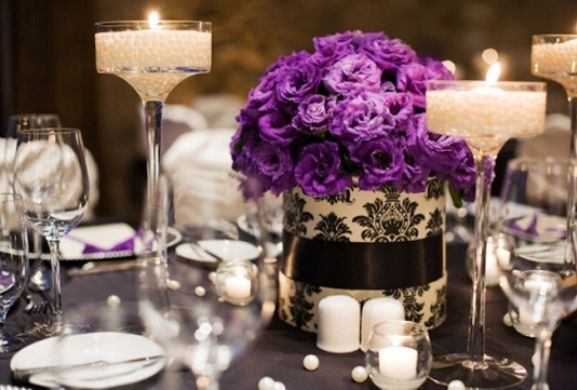 Floating Candle wedding centerpiece with purple flowers