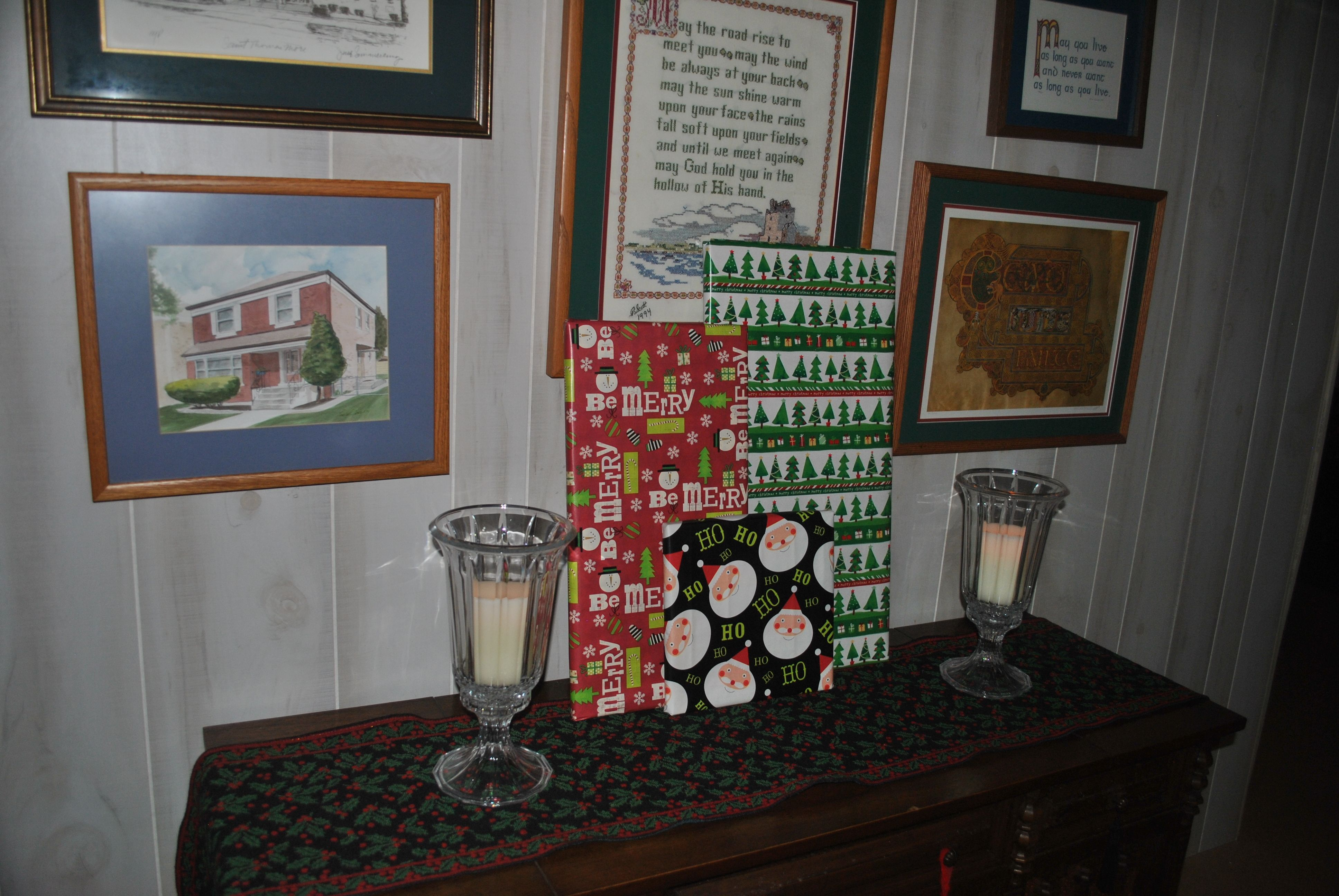 Another favorite paper decoration of mine is the covered canvas.  Inexpensive way of filling in a spot in need of a little Christmas.  In this case, it coordinates with the circles on the table.