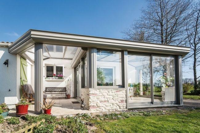 Véranda à toiture plate, une nouvelle tendance Extension - maison ossature metallique avis