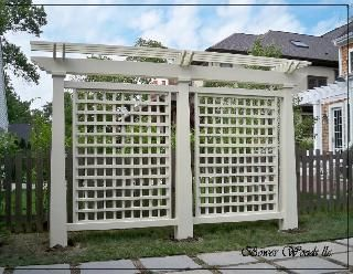 This Freestanding Trellis/pergola Looks Great While Effectively Screening  The Back Yard From The View