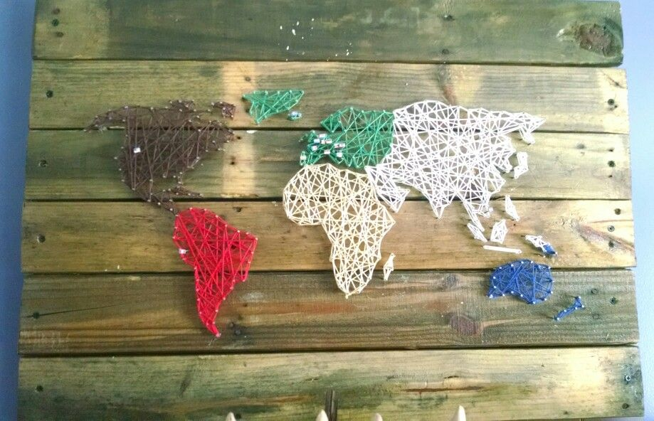 Super cool DIY idea! Use different colors of string for different continents, and put pins in all the countries you've been to.