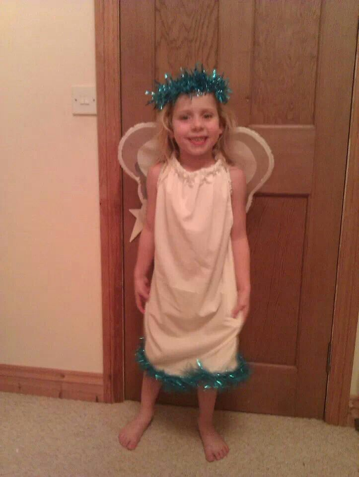 Pillowcase dress adapted to make angel costume for nativity.