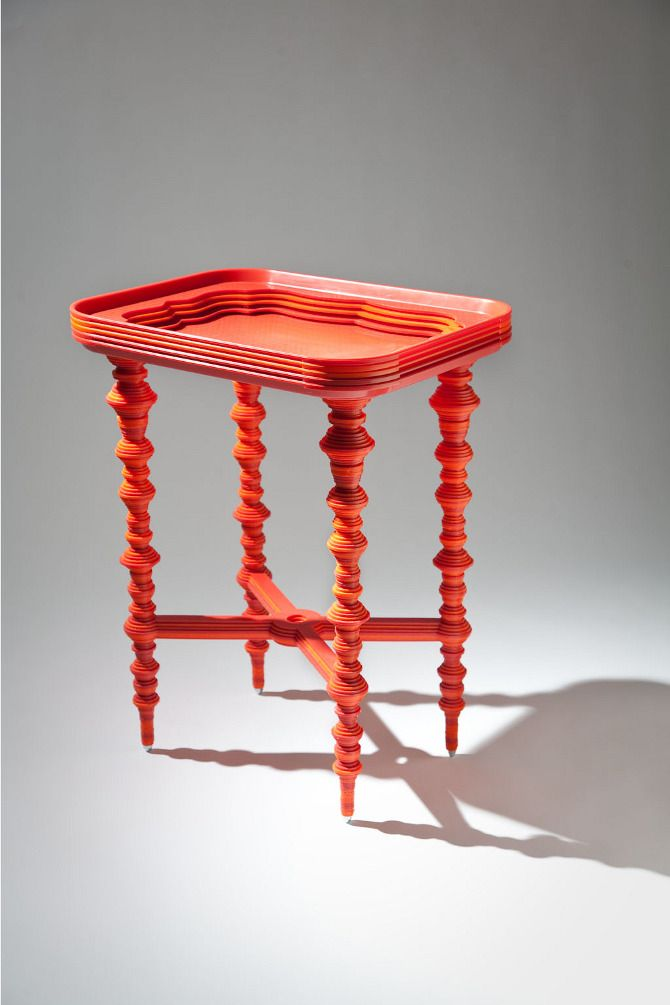 laser cut recycled cafeteria tray = cool side table. love the color.