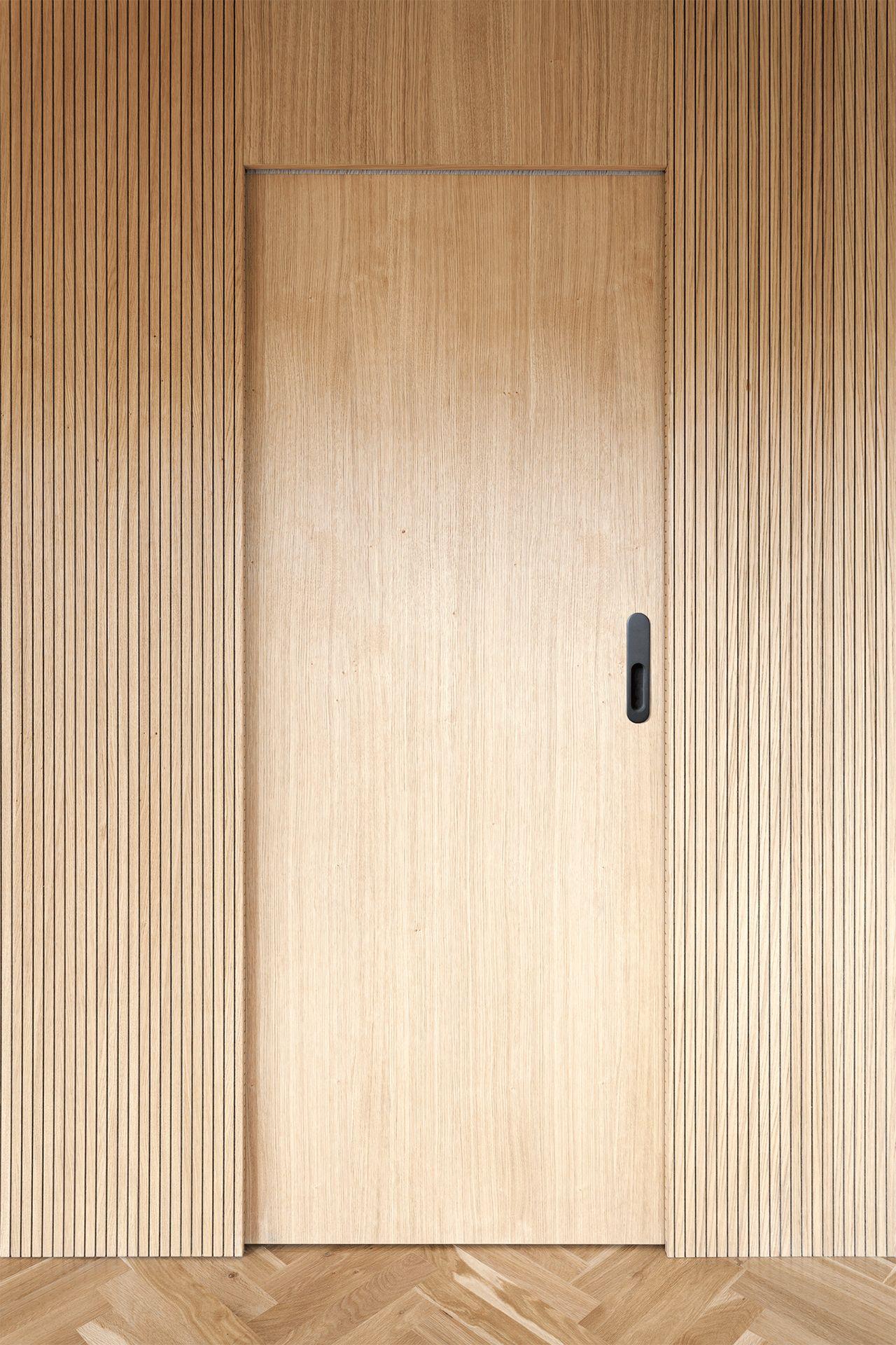 Material combinations and minimal details enrich a Prague ap…