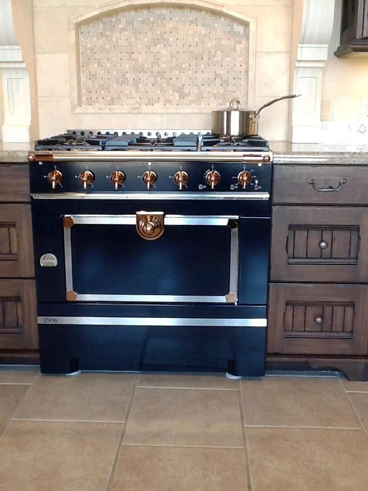 cornufe 1908 df 36 range brilliant black with copper accents vaulted oven with electric int. Black Bedroom Furniture Sets. Home Design Ideas