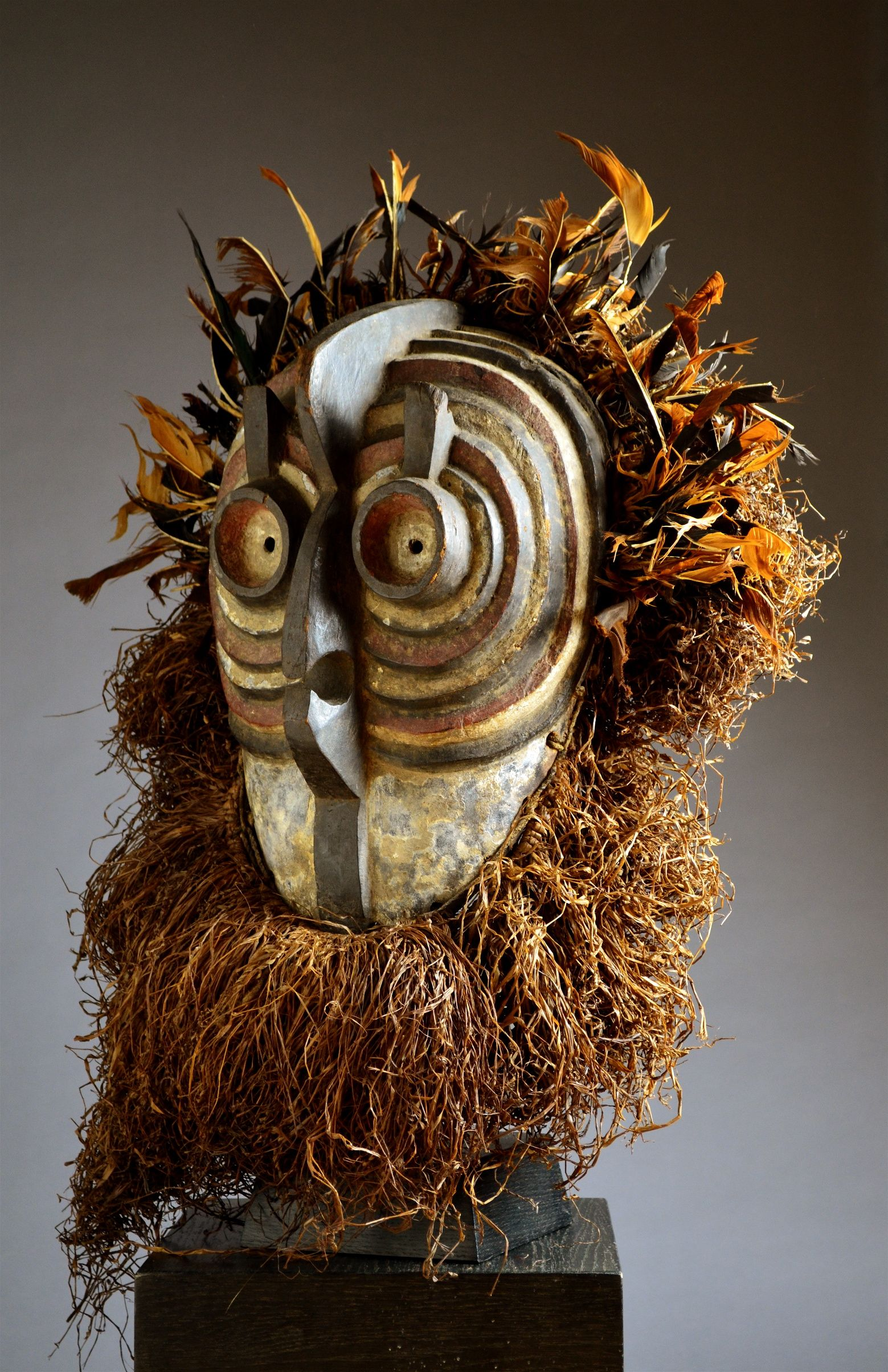 Ethnic group: Luba, Songye Country of origin : D.R.Congo Material : Wood, raffia, fibre, beads, shells Approximate age :  Mid 20th Century Dimensions: 41cm wooden part (67cm with raffia & feathers)