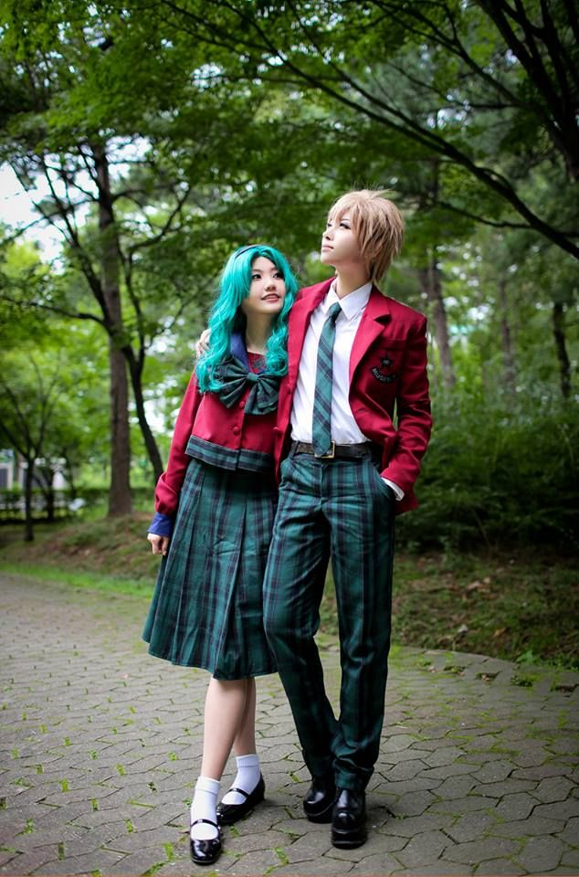 Here we have two wonderful Korean cosplayers as Haruka and Michiru. I think MiYo does an AWESOME job looking androgynous as I picture Haruka to be. heart emoticon Michiru is looking beautiful as well!
