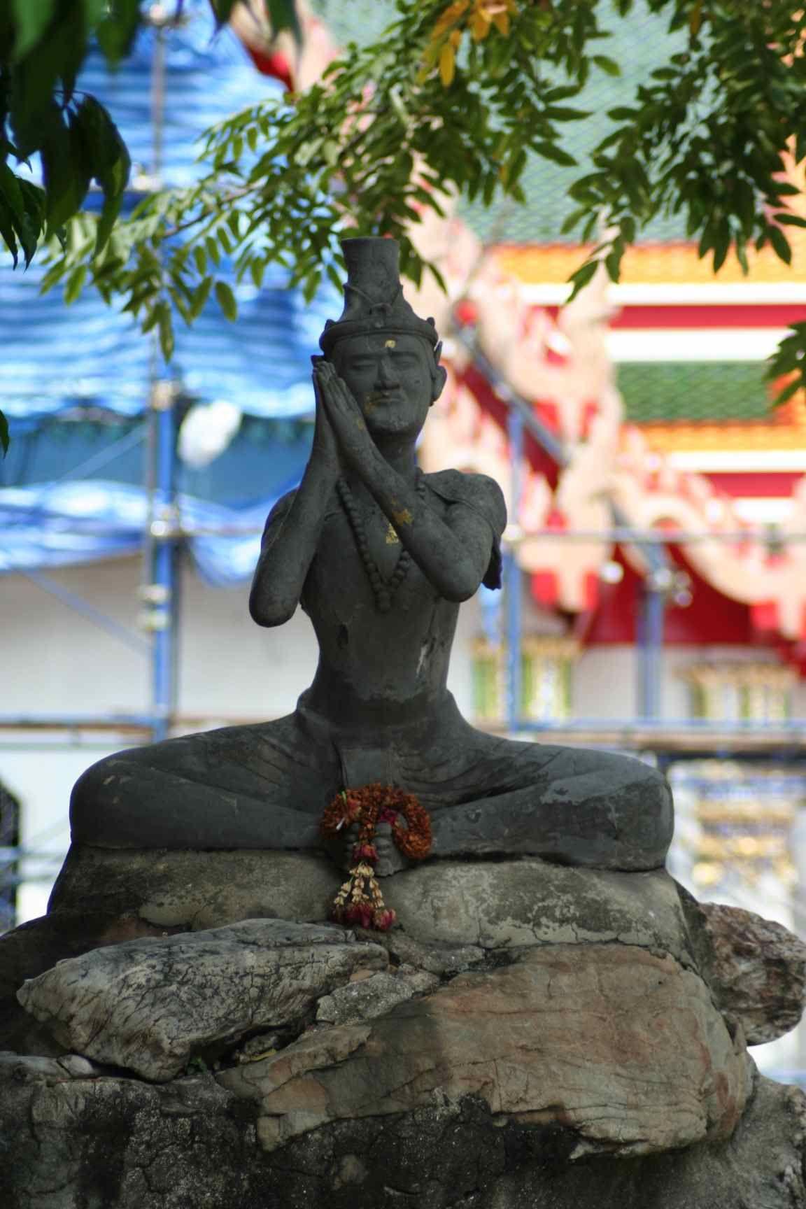 Wat Pho statue  Thai monk in prayer  Bangkok, Thailand
