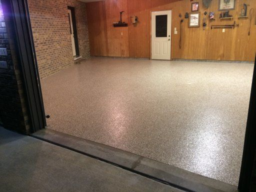 Finished garage epoxy flake flooring project by ProCrete Transformations in Chillicothe, Illinois.