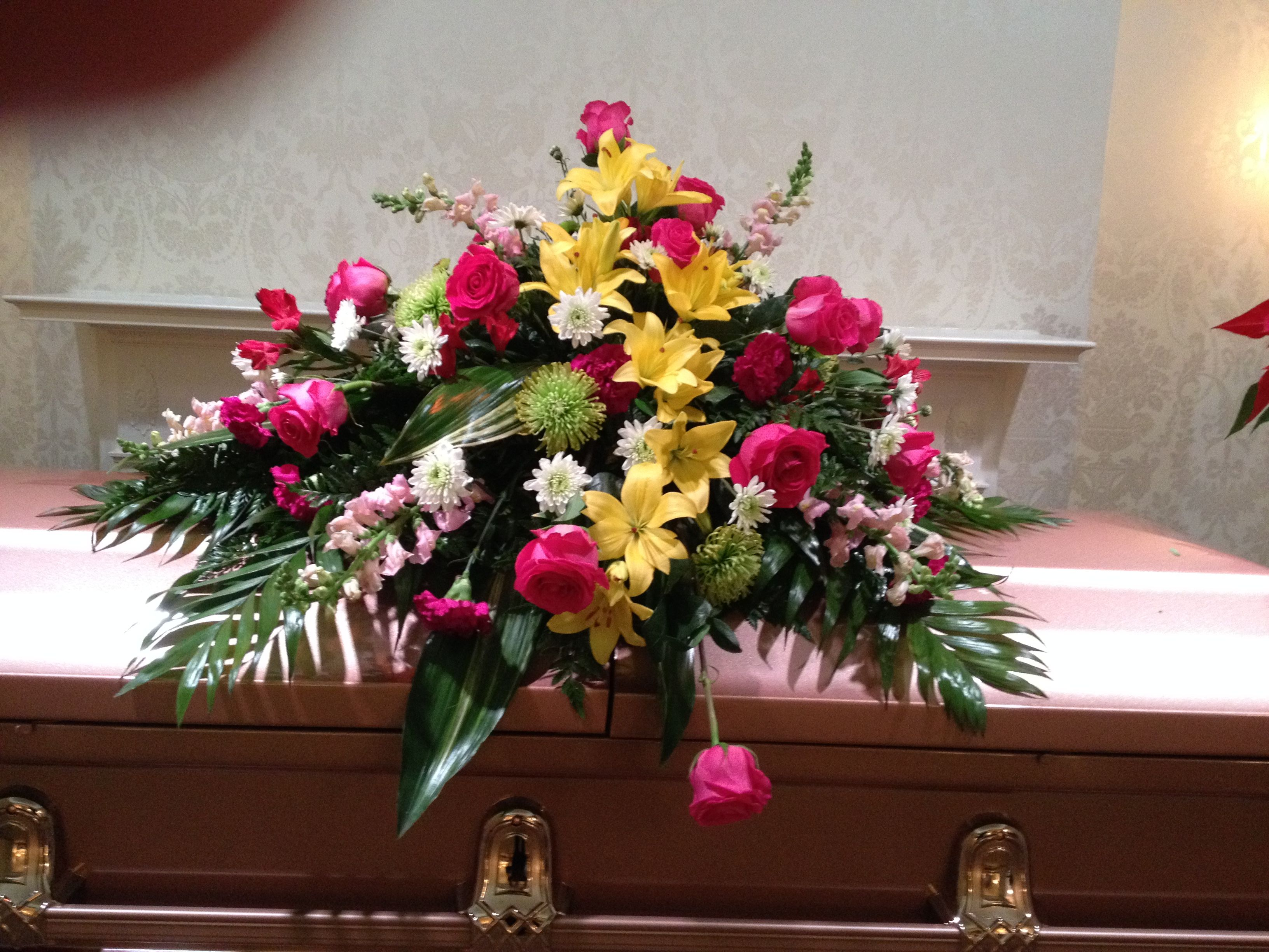 14 best funeral flowers images on pinterest funeral flowers the cascade of yellow lilies are the focal of this casket piece filled with pink izmirmasajfo Gallery