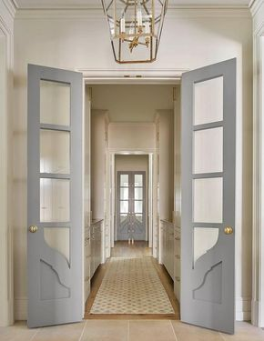 Gray bi fold doors with glass panels open to a galley style butlers gray bi fold doors with glass panels open to a galley style butlers pantry filled planetlyrics Choice Image