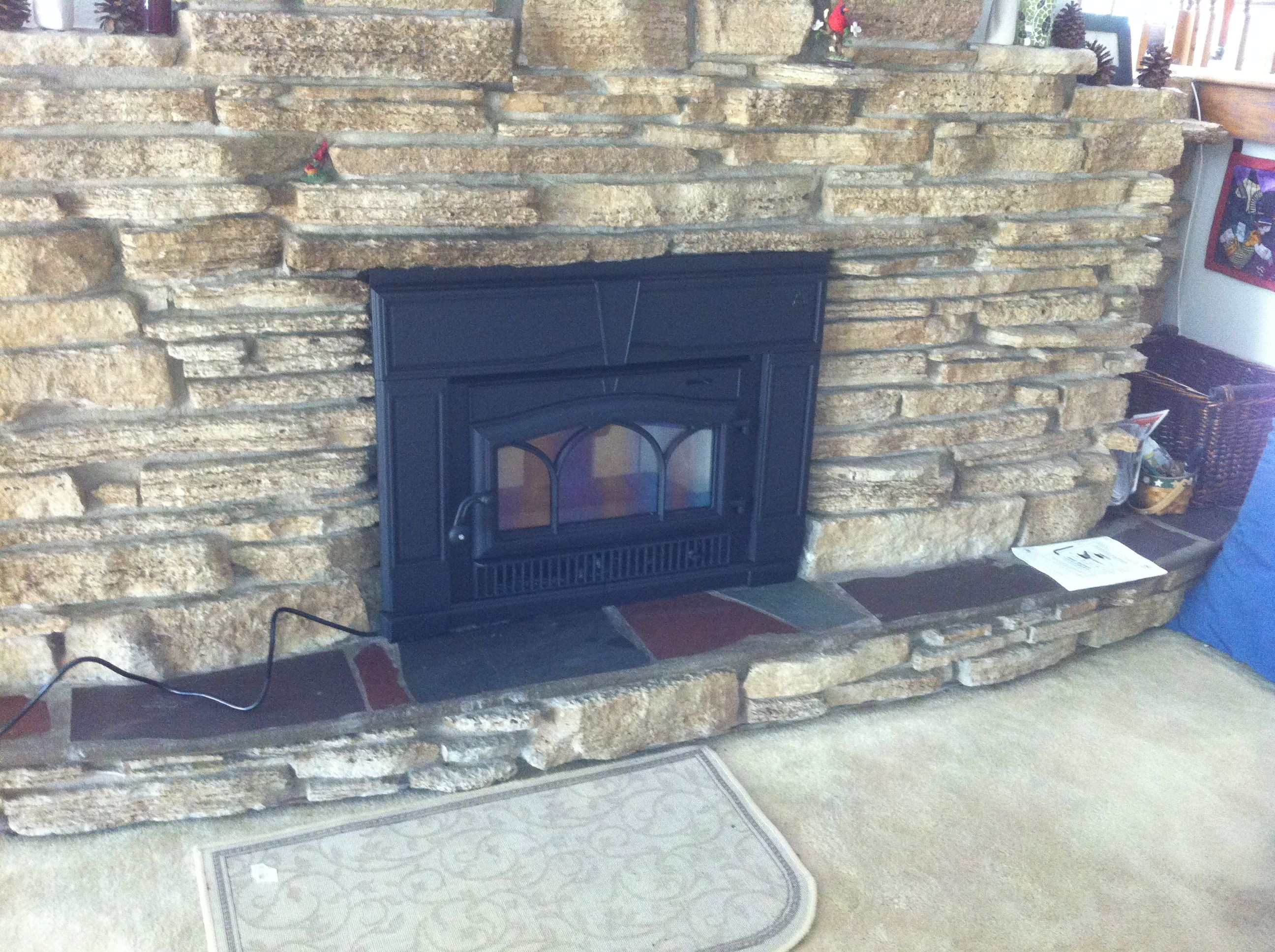 jotul wood burning fireplace insert rustic fireplace stone tiled