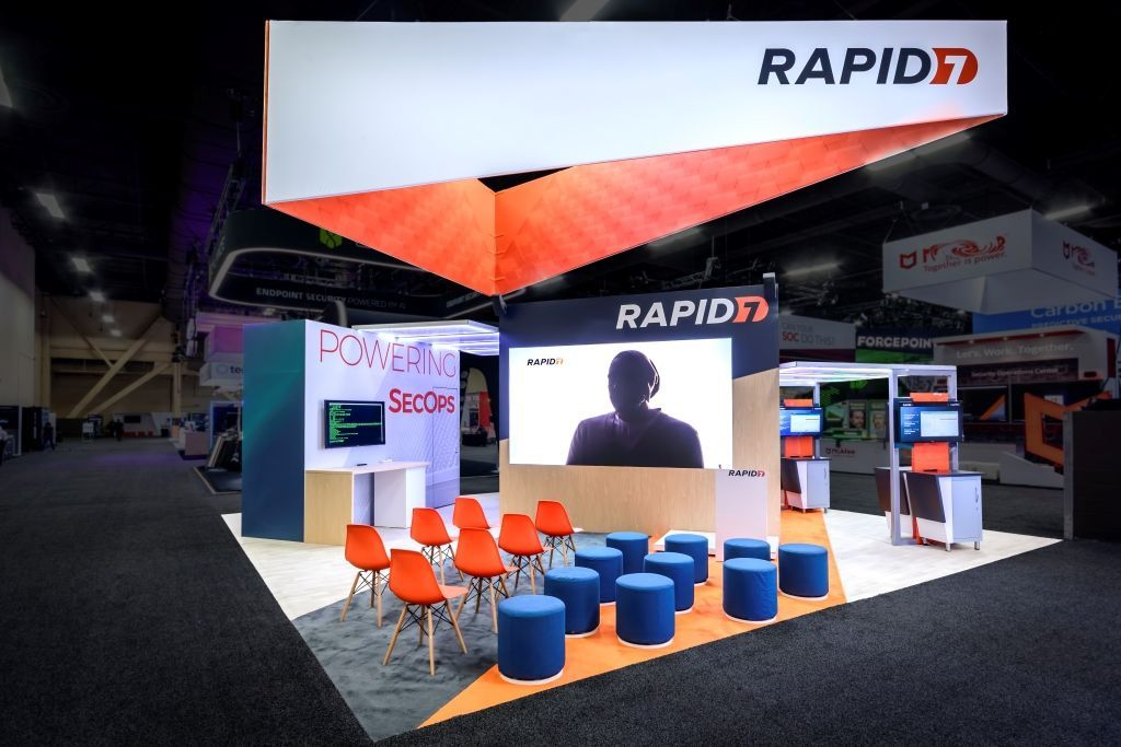 Exhibitor Rapid7 Llc Design Fabrication Hill Partners System Bematrix Photo Cole Group Event Branding Exhibition Stand Experiential Marketing