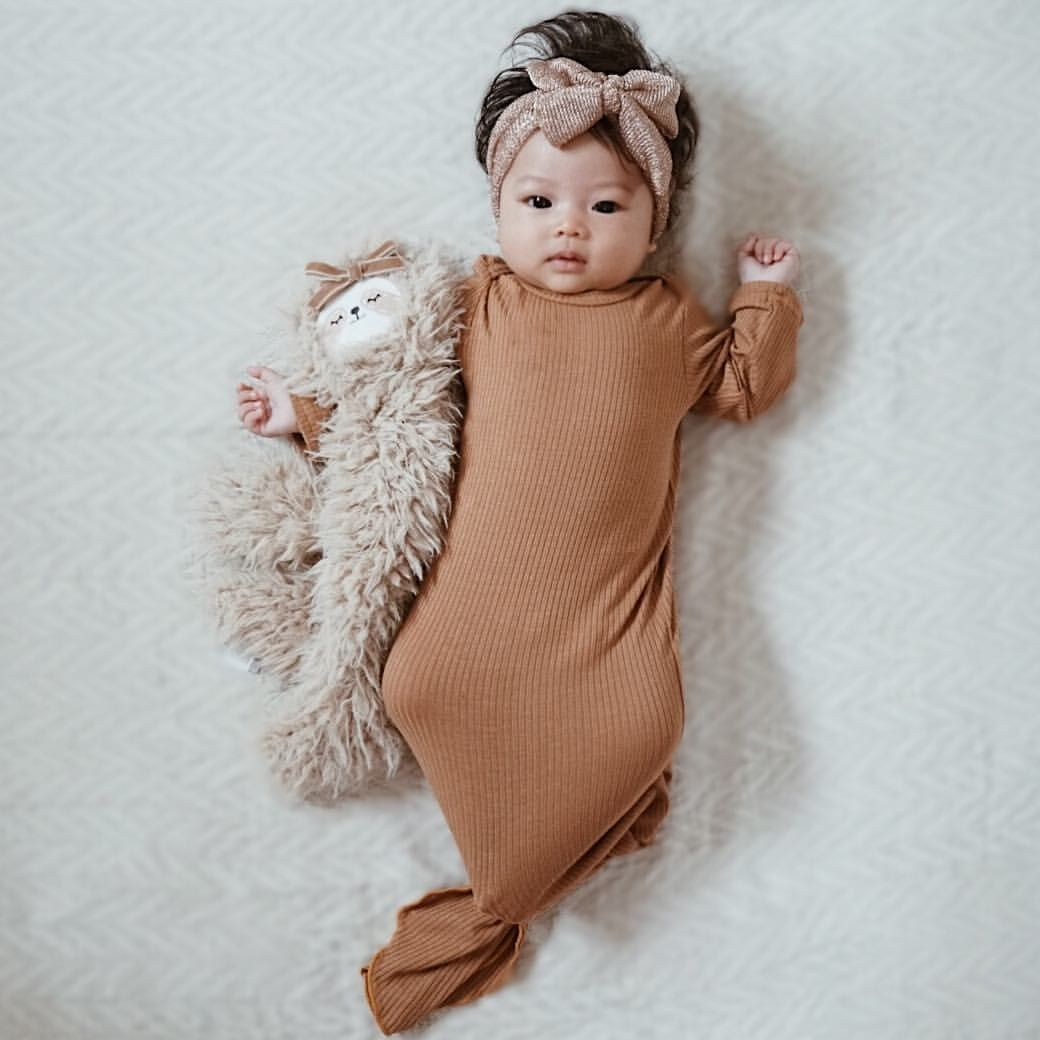 Beautiful baby girl in knotted gown, baby girl fashion, baby girl