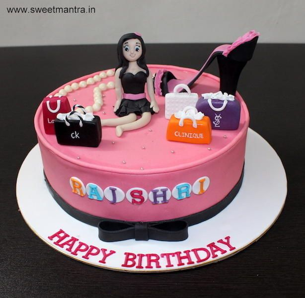 Shopping theme customized designer fondant cake with 3D girl figurine by Sweet Mantra - Customized 3D cakes Designer Wedding/Engagement cakes in Pune - http://cakesdecor.com/cakes/273624-shopping-theme-customized-designer-fondant-cake-with-3d-girl-figurine