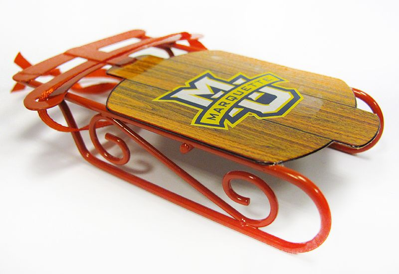 There may not be snow on campus, but there is a Marquette University sled ornament from the Spirit Shop.