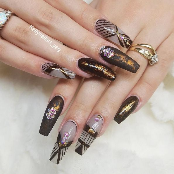 Beautiful dark graphic gel nails art design made by ...