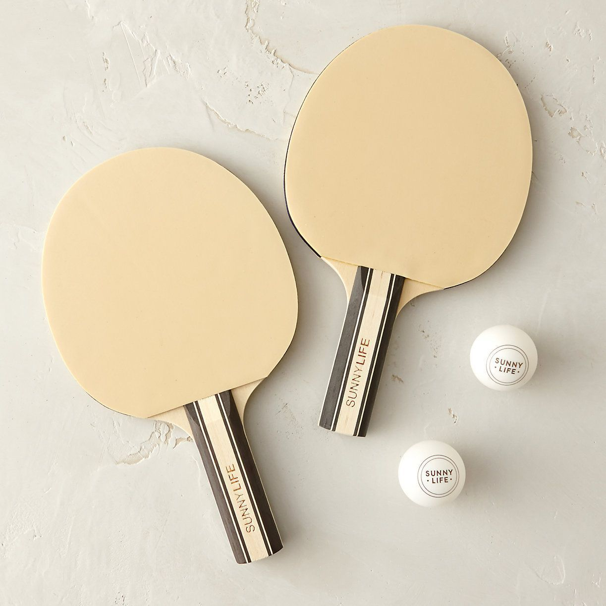Turn any table into a ping pong court with this playful set which includes an adjustable net plus two wooden paddles and balls. & Turn any table into a ping pong court with this playful set which ...