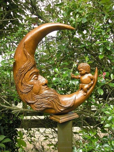 Moon baby wood carving by pauline lead up the garden path