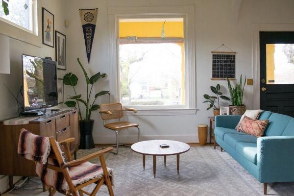 Living room inspiration in Portland, OR farmhouse with an eclectic and bohemian design style #bohodecor #boholivingroom #eclectichome #BohemianHomeDecorBlog
