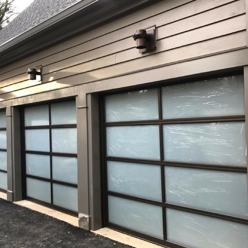 Aluminum Powder Coated Garage Door Frame With Frosted Insulated Glass  Panels Bring A Modern Style For Maximum Good Looks. | Pro Lift Garage Doors  | Clopay