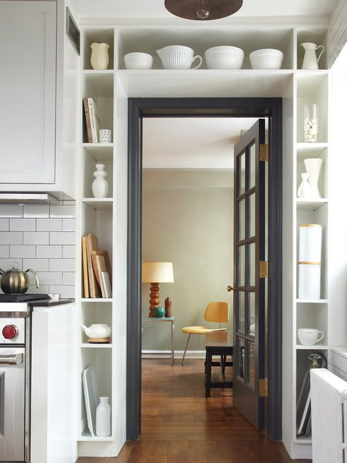 small urban u shaped kitchen photo in new york with recessed panel cabinets