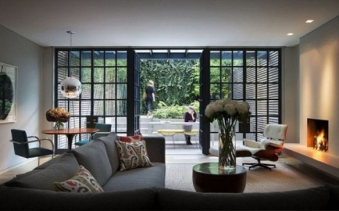 The sliding doors of this modern living room provide oriental