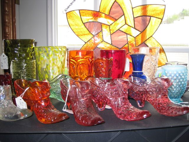 Fentor Slippers and colorful glassware.